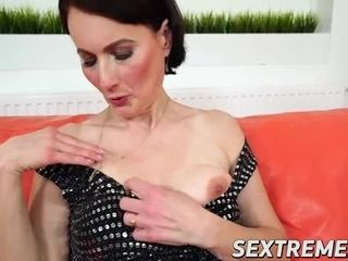 Seductive granny has her way with horny young stud on sofa