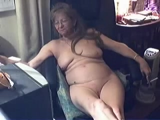 Messy overweight granny plays with her loose messy cleft on web camera