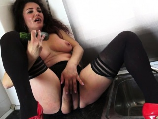 Spanish housewife Zazel Paradise frolicking with a cucumber