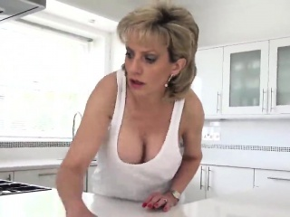 Cheating british mature gill ellis displays her heavy tittie