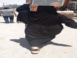 Splendid hijab mummy jiggling massive backside in the street - Falaha