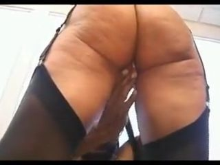 Sexy mature in stockings fucks black guy