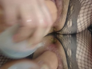 Tart in fishnets pounds herself with monster faux-cock