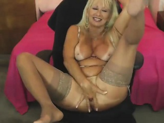 Busty mature blonde babe in stockings and mini skirt