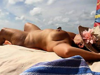 she is showing off her naked body on the beach