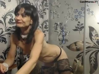Bony mature demonstrates assets on webcam