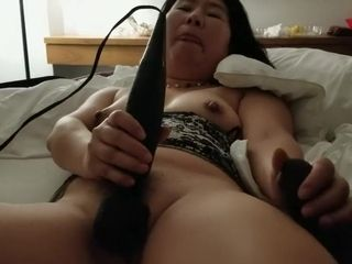 Japanese cougar plays with fresh plaything