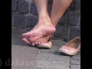 Grandmother paws her nude soles