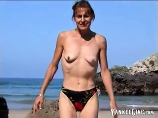 Wifey stripped to the waist on beach with petite empty saggy bra-stuffers