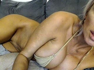 Ash-blonde mature lady plays with her hefty orbs at home