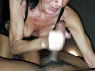 Gilf providing moist hand-job to big black cock