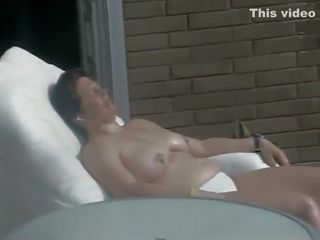 Mature neighbor woman caught tanning
