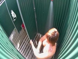 Mature lady caught in a beach shower